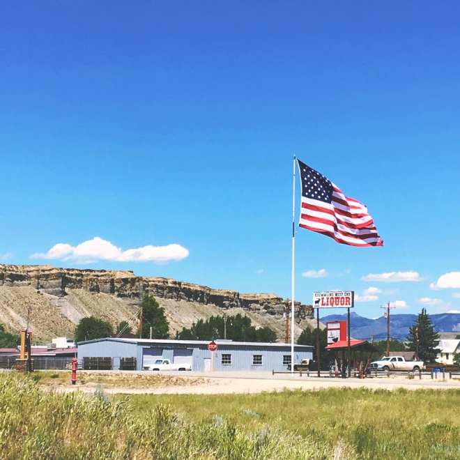 American flag over liquor store